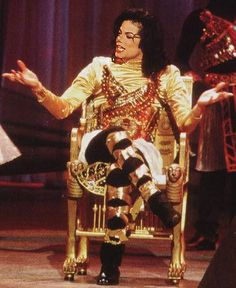 Michael Jackson - he had hurt his ankle so he had to sit down to sing this time :)  He wanted to dance so bad you can see it in the video on youtube :)