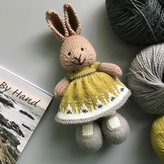 This dress features the border of the beautiful Telja sweater by Jennifer Steingass from By Hand Book Palette yarn in Lichen, Ash, White and Silver Knitted Bunnies, Knitted Animals, Knitted Dolls, Crochet Quilt, Crochet Toys, Knit Crochet, Knitting Projects, Knitting Patterns, Little Cotton Rabbits