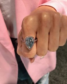 Blue Pear Shaped Diamond with Pink Diamond Halo and Band Pink Diamond Ring, Diamond Hoop Earrings, Pear Shaped Diamond, Diamond Jewelry, Pear Shaped Engagement Rings, Round Diamond Engagement Rings, Diamond Wedding Bands, Wedding Rings, Silver Diamonds