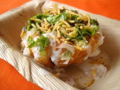 Khasta Kachori Chaat (Puri Stuffed with a Dry, Spiced Lentil Filling Topped with Chutney and Yogurt).