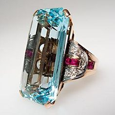 $10,929 Vintage ring... to tell you the truth I don't like the rubies with it.  Love the aquamarine stone though.  p/i