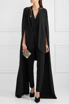 ANTONIO BERARDI Chain-embellished crepe cape $2,495 Antonio Berardi's cape first caught our attention on the Spring '17 runway in London. Detailed with gilded chain hardware at the neckline, it's tailored from structured crepe and cut shorter at the back to accentuate the long, flowing sides. We like it best styled in an all-black palette.   Shown here with: Antonio Berardi Pants, Mugler Top, Charlotte Olympia Clutch, Prada Pumps, Charlotte Chesnais Rings.