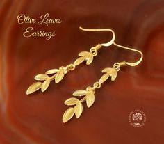 olive leaves golden dangle earrings, olive leaf, golden olive leaf, olive leaf earrings, greek earrings, olive leaves, leaf earrings  These are dangle earrings with olive leaves made of sterling silver 925 gold plated - 24 K gold.  For the ancient Greeks the olive tree was a symbol of peace and victory. The olive wreath - kotinos – crowned heads of the Olympic winners. It was made of an olive branch from the wild olive tree that grew in Olympia.  Emphasize your exceptional natural beauty…