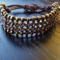 Adjustable rhinestone bracelet Gold/brown/crystal drawstring bracelet with double row of rhinestones and gold bead accents. Like new! J. Crew Jewelry Bracelets