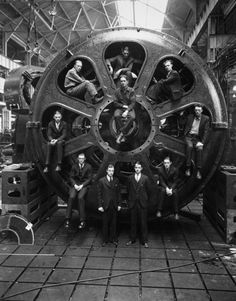 Posed with the motor built by General Electric are student engineers who assisted in testing the motor to be used to propel the S.S. Virginia, world's largest electric passenger ship, at the factory in Schenectady, New York, 1928.