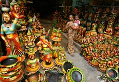 A girl carrying a child walks past clay sculptures kept on display at a roadside shop ahead of the Hindu festival of Diwali in New Delhi, India on October 16th, 2009. (REUTERS/Parth Sanyal) #