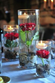 Easy elegance, using distilled water and silk flowers and adding the floating candles.