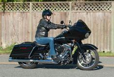 """Debra Neumann of Seattle, Washington, traded in her Road King for this 2012 Road Glide saying she was ready for a bike with a fairing. """"The Road Glide is one of the best handling tour bikes, in my opinion,"""" she says. """"It has a bigger front touring tire than the Street Glide, and it handles extremely well around the corners. I love having music and cruise control on the long rides."""" Photo by Karen Derby."""