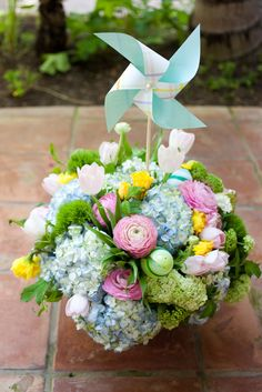 Spring Wedding Decor-- omg pinwheels would be so cute... maybe along the aisle