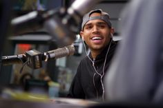 Chris Brown in the studio at KIIS with Ryan Seacrest.