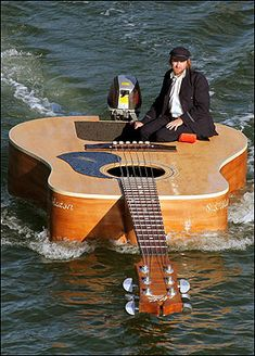 Guitar boat...this man deserves a standing ovation...or at least to jump into a crowd of screaming fans