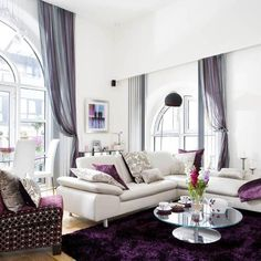 grey curtins, white furniture, purple accents and bedding