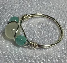 Handcrafted wire-wrapped Moonstone (June's birthstone) and Amazonite bead ring. Beads consist of one 7mm Moonstone and two 4mm dyed Amazonite. Wire is silver-pl