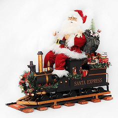 The Train Engine Santa with Track Santa from Karen Didion Originals brings Christmas joy into your home. The quality of this figurine is unmatched with its hand-painted face, glass inset eyes, real mohair beard, unique fabric, and detailed accessories.