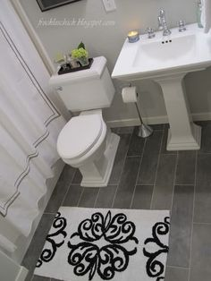 Plank bathroom floor tiles.