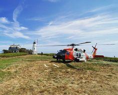 A U.S. Coast Guard MH-60 Jayhawk helicopter near Wood Island Lighthouse in Saco Bay, Maine. Patriotic Poems, Coast Guard, Lighthouse, Maine, United States, America, Island, Wood, Bell Rock Lighthouse