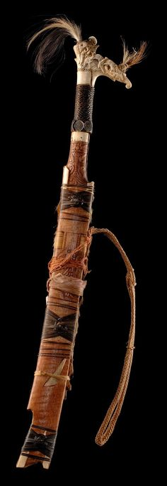 "Sword ""mandau"" with wooden scabbard, Indonesia – Borneo, Dayak Swords And Daggers, Knives And Swords, Indonesian Art, Sword Design, Medieval Weapons, Plant Fibres, Arm Armor, Iron Art, Fantasy Weapons"