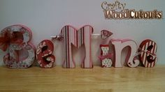 """This February Be Mine Wood Letter Set costs $17.99 and is about 29"""" wide and 8.5"""" tall."""