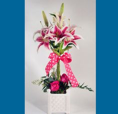 STARGAZER TOPIARY: This beautiful topiary, is such a treat for the eyes of lily lovers. Done in a white lattice ceramic container, and accented with roses around the base, and finished off with a precious pink polka dot bow. #MatlackFlorist