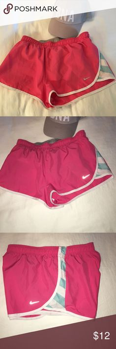 Nike Dry Fit Small Pink & Blue Striped Shorts Nike Dry Fit shorts in a darling pink with Tiffany blue striped accenting. Interior grey liner with blue drawstring. Very comfortable and breathable! Used lightly and in good condition. Size Small. Fits size 4-6. Nike Shorts