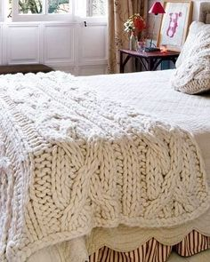 Big chunky cableknit throw. Hobby Lobby has them in off white, navy and black