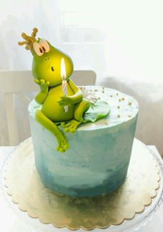 Adorable Princess and the Frog cake - fondant or modeling chocolate figure on to...