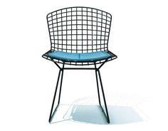 knoll bertoia side chair with seat cushion. Harry Bertoia's experiment with bending metal rod produced a collection of seating, including the Bertoia side chair