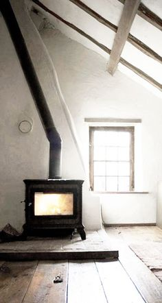 = white, wood, and pot belly stove