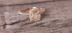 Reserved - Jasmine to Peach color change sapphire in 14k rose gold diamond ring. $2,000.00, via Etsy.