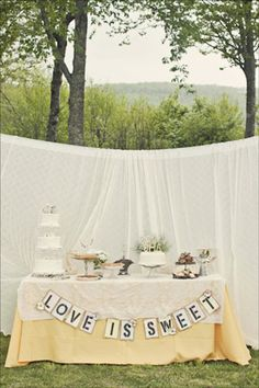 "The dessert table at Abby and Julian's outdoor affair housed a variety of confections and was decorated with a handmade garland sign that read ""Love is Sweet"". The backdrop was made from window curtains that had been sewn together. Wedding Signs, Our Wedding, Destination Wedding, Wedding Stuff, Wedding Rentals, Wedding Reception, Lace Wedding, Wedding Flowers, Decoration Inspiration"