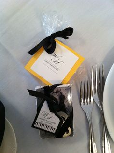 Music-themed place favor at the fall 2012 Women's Auxiliary Luncheon. A music note sugar cookie and music bookmark. Tags and boxes were handcrafted.