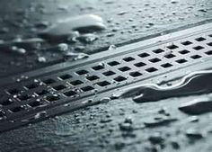 Gutter drain for roll in shower