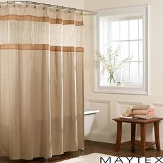 A stunning addition to any bathroom, this Buena Vista shower curtain features subtle floral and vine embroidery on a sheer panel. This fabric shower curtain showcases a lovely natural hue with a touch of gold.