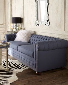 I love this blue tufted couch.  It is quite expensive, but this would be such a great living room piece!