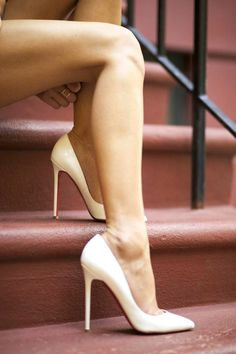 Christian Louboutin pigalles white pumps. Please, please put some white stockings on