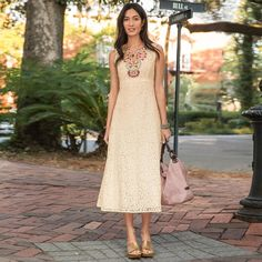"""HONEYSUCKLE LACE DRESS--Exquisite lace and embroidery define our vintage-inspired maxi-length dress. Fully lined bodice with  full-sweep skirt. Side zip. Cotton/nylon lace. Hand wash. Imported. Exclusive. Sizes 2 to 16. Approx. 49-1/2""""L."""