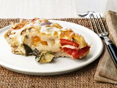 Ina packs her frittata full of zucchini, bell peppers, onions and cheese.