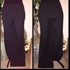 """New York & co career trousers Black pinstripe career pants.. They are black with a tiny white pinstripe.. Perfect for the office or a night out.. Mint condition.. There is a shadow from the flash on the leg of the pants.. It's only a shadow.. 31 1/2"""" inseam and bottom width of hem is 10 1/2"""" so I would call them a wide leg trouser fit New York and Company Pants Trousers"""