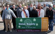 Union County Freeholder Chairman Alexander Mirabella (C), Vice Chairman Linda Carter (3rd  R) and (from 3rd  L) Freeholders Angel G. Estrada, Christopher Hudak, Deborah Scanlon, Vernell Wright and Mohamed Jalloh join Union County employees at the 16th annual Union County St. Patrick's Day Parade in Union on March 10.