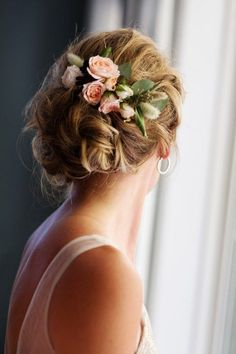 blush flowers and leaves for a cool twisted wedding updo