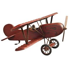 Large Red Painted Wooden Model Bi-Plane | From a unique collection of antique and modern toys at http://www.1stdibs.com/furniture/folk-art/toys/
