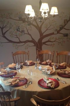 Family tree painting on wall with family pictures// love.
