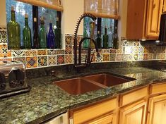 Here's a variety of beautiful DIY backsplash ideas for redesigning your kitchen wall. Diy Kitchen backsplash pictures for your inspiration: Mexican diy tile backsplash Bottle caps diy backsplash … Mexican Tile Kitchen, Mexican Kitchens, Kitchen Wall Tiles, Kitchen Backsplash, Diy Kitchen, Backsplash Ideas, Mexican Tiles, Mexican Spanish, Mosaic Backsplash