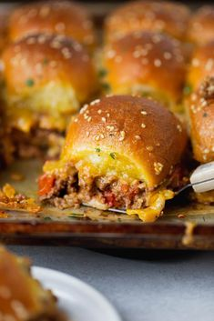 These cheeseburger sliders from Oh Sweet Basil are the perfect tailgating party food. They are cheesy, beefy and so juicy – everything we love about cheeseburgers, and so easy to make! Cheeseburger Sliders, Cheeseburgers, Fall Recipes, Dinner Recipes, Dinner Ideas, Herb Roasted Potatoes, Slider Buns, Dinner Rolls Recipe, Slider Recipes
