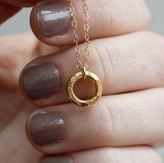 hammered gold circle necklace. simple & sweet.