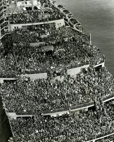 U.S.A. Crowded ships brought American troops back home to New York harbour for months after the V Day in 1945.