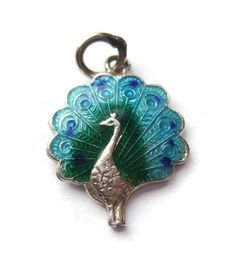 Vintage peacock charm, guilloche enamel and sterling silver, turquoise, royal blue and green bird charm, https://www.etsy.com/listing/220909613/vintage-peacock-charm-guilloche-enamel