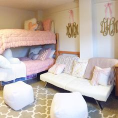 Cute and posh dorm room at Indiana University! Hanging gold monograms with pink ribbon and pbteen comforters!