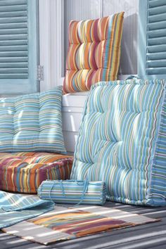 These pillows remind us of the colors you find in Key West. They would be perfect as chair cushions.