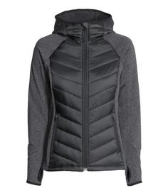 Lightweight fitted jacket with padding front and back. Lined hood, front zip, side pockets with zip, and thumbholes at cuffs. Rounded hem, slightly longer at back. Sleeves and side sections with brushed thermal inside.
